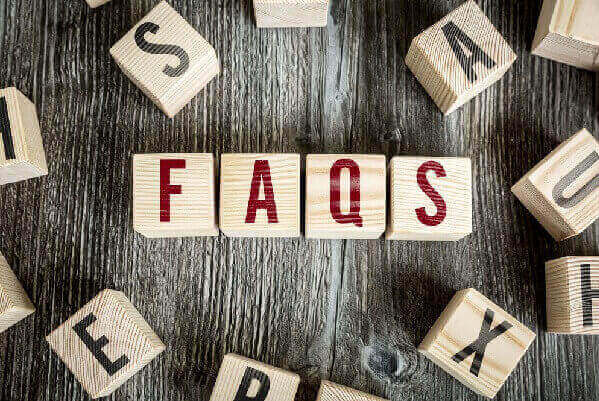 Wooden blocks with the word FAQS on the table.
